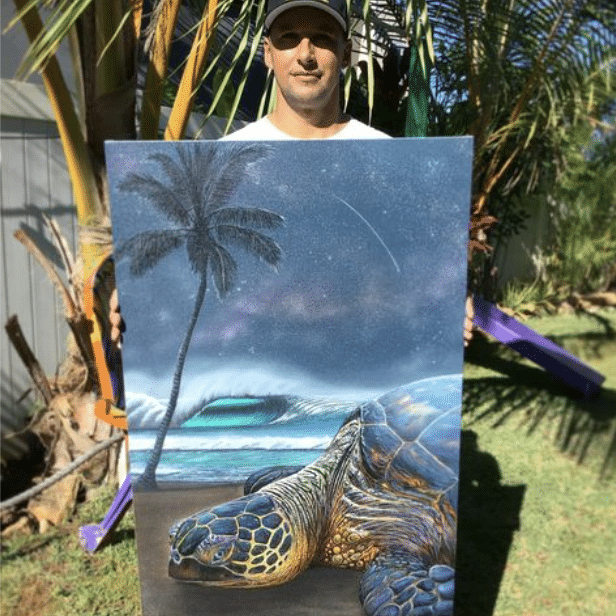 artist hilton alves making a wish turtle painting