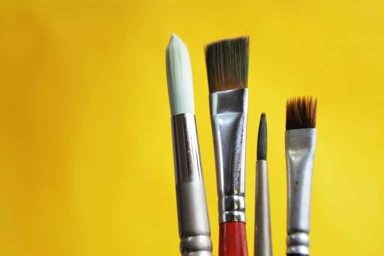 artist-paint-brushes-in-row-yellow-background